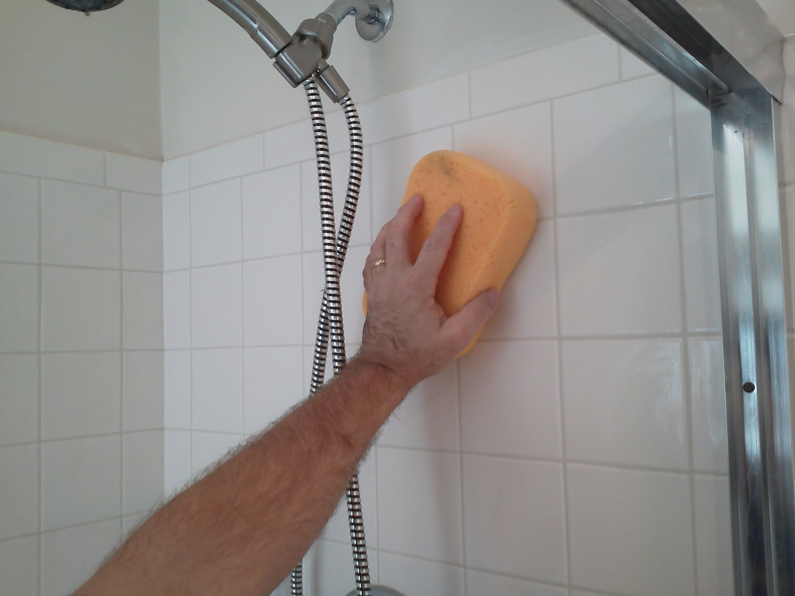 How to regrout a shower pristine tile carpet cleaning sponging the tile goout dailygadgetfo Images