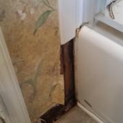 Water damage around bathtub