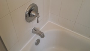 After the surfaces are properly prepared, new caulk is installed, making this tub water tight once again.